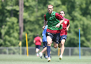Jimmy Conrad leads Landon Donovan (behind) in a fitness exercise on Wednesday, May 17th, 2006 at SAS Soccer Park in Cary, North Carolina. The United States Men's National Soccer Team held a training session as part of their preparations for the upcoming 2006 FIFA World Cup Finals being held in Germany.