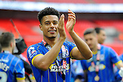 AFC Wimbledon striker Lyle Taylor (33) celebrates promotion in front of the AFC Wimbledon fans after the Sky Bet League 2 play off final match between AFC Wimbledon and Plymouth Argyle at Wembley Stadium, London, England on 30 May 2016. Photo by Graham Hunt.