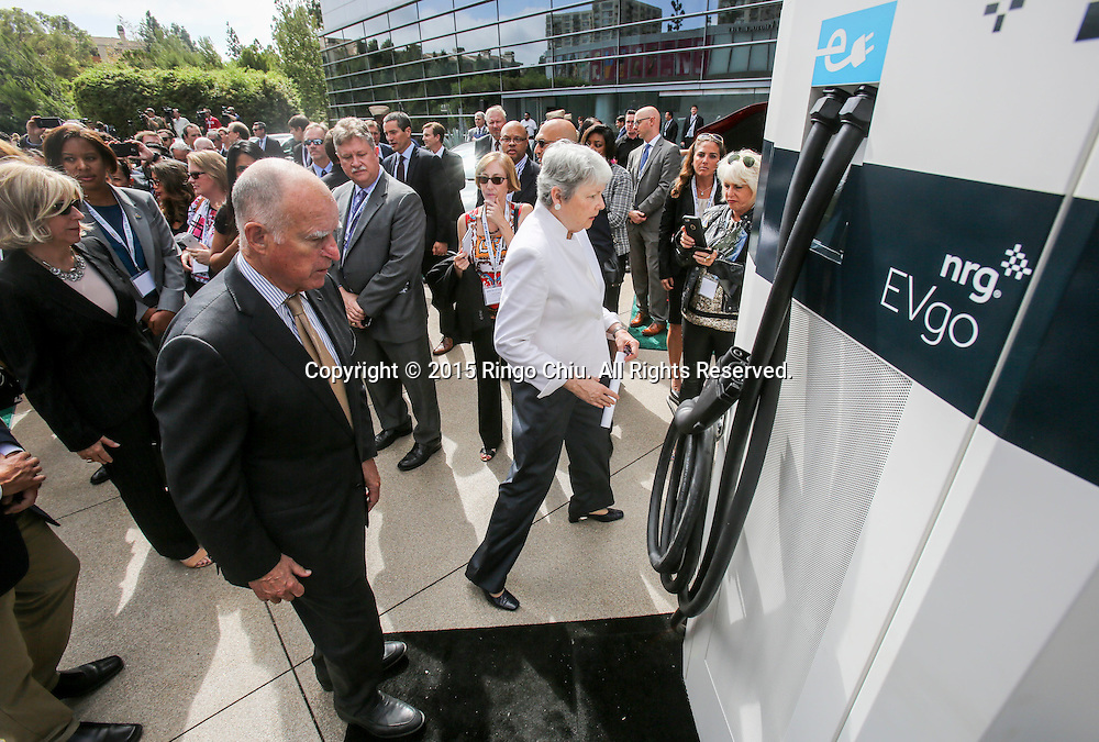 California Gov. Jerry Brown takes a closer look at the NRG eVgo electric car charging station in Drive the Dream 2015 event at Creative Artists Agency in Los Angeles October 15, 2015.  (Photo by Ringo Chiu/PHOTOFORMULA.com)