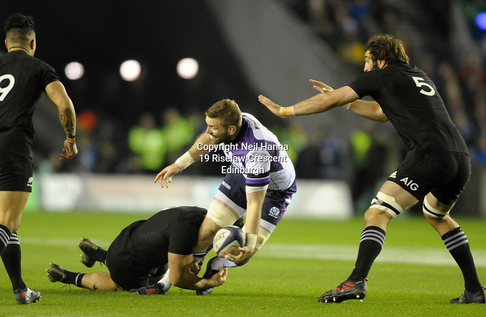 Scotland v New Zealand Saturday 18th November 2017 BT Murrayfield, Edinburgh.<br /> <br /> John Barclay of Scotland tackled by Codie Taylor of New Zealand<br /> <br />  Neil Hanna Photography<br /> www.neilhannaphotography.co.uk<br /> 07702 246823