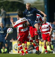 Photo: Chris Ratcliffe.<br />Southend United v Doncaster Rovers. Coca Cola League 1. 22/04/2006.<br />Luke Guttridge (R) of Southend is beaten to the ball by Sean McDaid of Doncaster