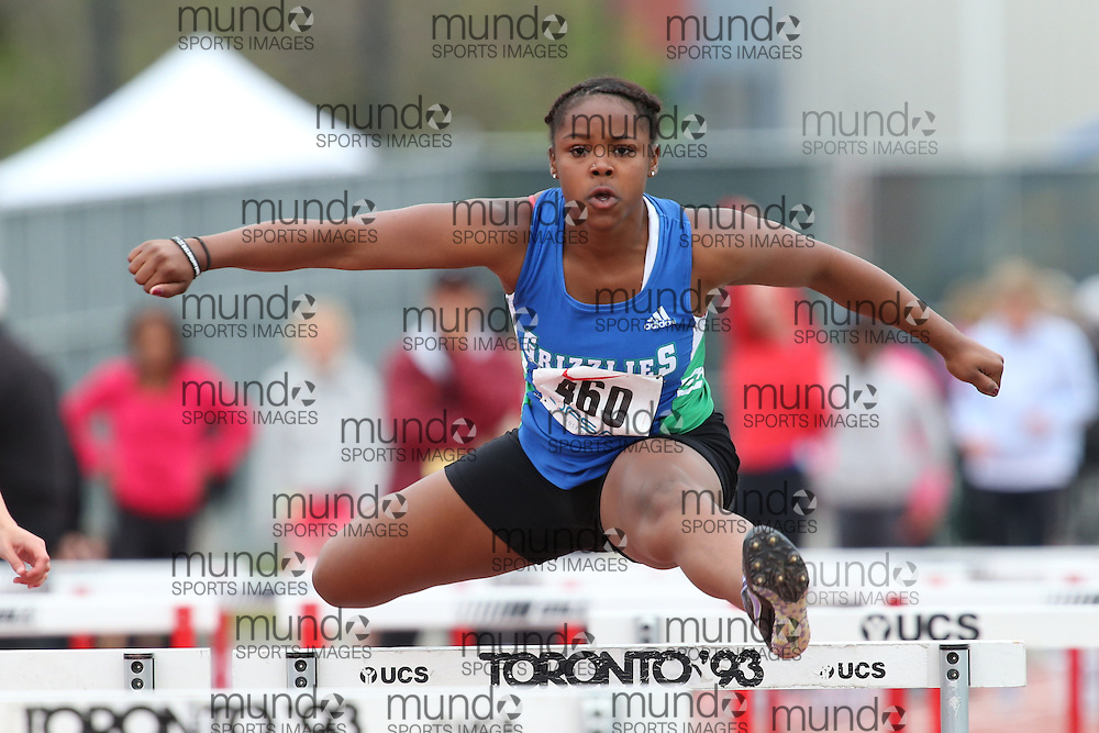Kyliene Downey-Sparkes of David Suzuki SS - Brampton competes in the sprint hurdle heats at the 2013 OFSAA Track and Field Championship in Oshawa Ontario, Thursday,  June 6, 2013.<br /> Mundo Sport Images / Sean Burges