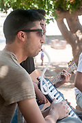 young man plays the Melodica outdoors
