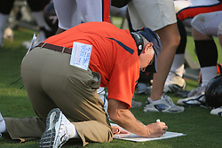Virginia head coach Al Groh draws up a play along the sidelines against Wyoming.  The Virginia Cavaliers defeated the Wyoming Broncos 13-12 in overtime on September 9, 2006 at Scott Stadium in Charlottesville, VA.