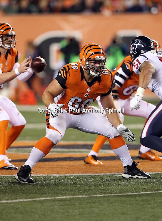 Cincinnati Bengals guard Kevin Zeitler (68) pass blocks Houston Texans outside linebacker John Simon (51) during the 2015 week 10 regular season NFL football game against the Houston Texans on Monday, Nov. 16, 2015 in Cincinnati. The Texans won the game 10-6. (©Paul Anthony Spinelli)