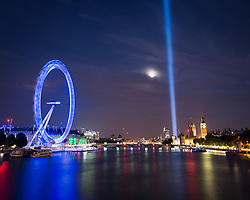 © Licensed to London News Pictures. 06/08/2014. London, UK. A column of light illuminates London.The beam of light was switched on to mark 100 years since Britain entered World War One. The light comes from 49 beams placed behind the House of Lords and can be seen throughout the capital after dark.Photo credit : Andrew Steele/LNP