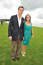 NICHOLAS VAN CUTSEM and his fiance ALICE HADDEN-PATON at the 25th annual Cartier International Polo held at Guards Polo Club, Great Windsor Park, Berkshire on 26th July 2009.