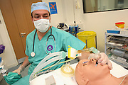 Phil, the OPD (Operating Department Practitioner) is providing oxygen to one of the 'Patient Simulator' during a heart attack simulation at the ExPERT Centre, a new wing of the University of Portsmouth, on Wednesday, March 28, 2007, in Portsmouth, England. The 'Patient Simulators' can bleed, breathe, drool and even speak, and are being used by students at the state-of-the-art new training centre. They cost 270.000 USD each and are able to simulate all sort of acute conditions, including heart attacks. The 'Patient Simulators' are housed at a $9 million USD centre which opened few weeks ago. Students and professionals from different health-care disciplines simulates conditions to then act and provide the right treatment, while the 'patient' will react accordingly. www.port.ac.uk/expertcentre  **Italy Out**