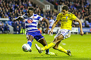 Birmingham City midfielder Jude Bellingham (22) shoots towards the goal challenged by Reading defender Andy Yiadom (17) during the EFL Sky Bet Championship match between Reading and Birmingham City at the Madejski Stadium, Reading, England on 7 December 2019.