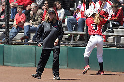 26 April 2015:   Melinda Fischer stands looking at the field as Kelsey Turczyn warms up in the on deck circle behind her during an NCAA Missouri Valley Conference (MVC) Championship series women's softball game between the Loyola Ramblers and the Illinois State Redbirds on Marian Kneer Field in Normal IL
