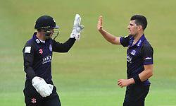 Benny Howell of Gloucestershire celebrates with Geraint Jones of Gloucestershire after bowling out Fabian Cowdrey of Kent - Photo mandatory by-line: Dougie Allward/JMP - Mobile: 07966 386802 - 12/07/2015 - SPORT - Cricket - Cheltenham - Cheltenham College - Natwest Blast T20