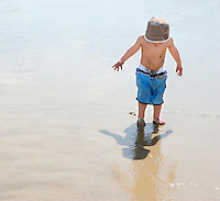 Boy (3-4) on beach