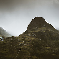 The three Sisters under a heavy sky on a dreich day in Glen Coe