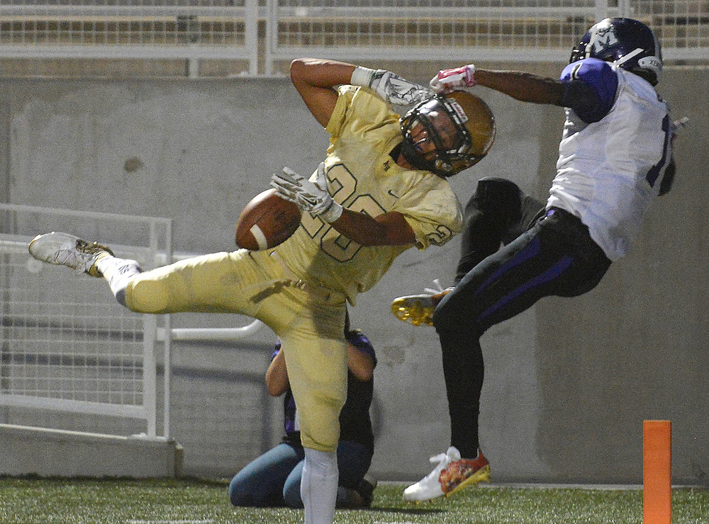gbs082516m/SPORTS --  Atrisco Heritage's Angel Ramirez, 28, breaks up the touchdown intended for Manzano's  Jordan Byrd, 1, in the first half of the game  at Community Stadium on Thursday, August 25, 2016. (Greg Sorber/Albuquerque Journal)