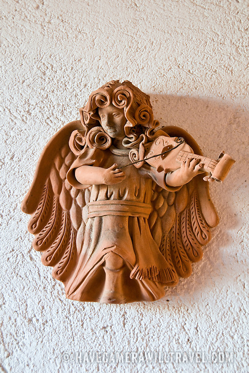 Pottery decorations of angelic musical figures at Zihuatanejo, Mexico