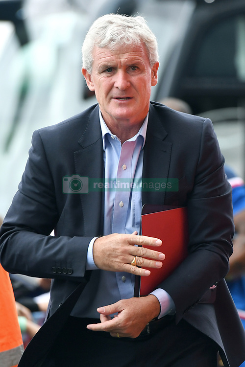 """Stoke City manager Mark Hughes arrives for the pre-season match at the Macron Stadium, Bolton. PRESS ASSOCIATION Photo. Picture date: Saturday July 29, 2017. See PA story SOCCER Bolton. Photo credit should read: Anthony Devlin/PA Wire. RESTRICTIONS: EDITORIAL USE ONLY No use with unauthorised audio, video, data, fixture lists, club/league logos or """"live"""" services. Online in-match use limited to 75 images, no video emulation. No use in betting, games or single club/league/player publications."""