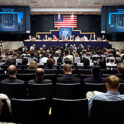 """Commission staffers present Staff Statement No. 15, """"Overview of the Enemy."""" The photo on the screens is of Khobar Towers bombing on June 25, 1996. The 9/11 Commission's 12th public hearing on """"The 9/11 Plot"""" and """"National Crisis Management"""" was held June 16-17, 2004, in Washington, DC."""