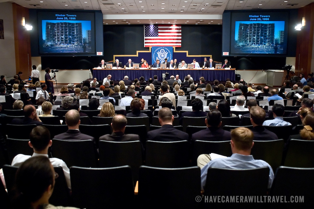 "Commission staffers present Staff Statement No. 15, ""Overview of the Enemy."" The photo on the screens is of Khobar Towers bombing on June 25, 1996. The 9/11 Commission's 12th public hearing on ""The 9/11 Plot"" and ""National Crisis Management"" was held June 16-17, 2004, in Washington, DC."