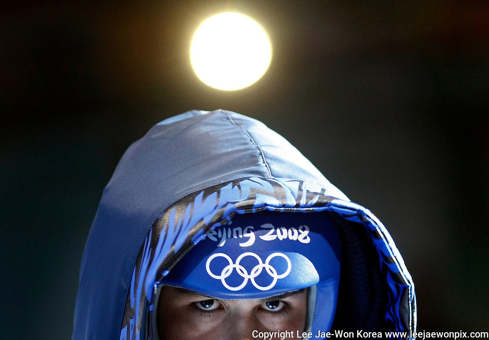 Javier Molina of the U.S. arrives for his men's light welterweight (64kg) round of 32 boxing match against Boris Georgiev of Bulgaria at the Beijing 2008 Olympic Games August 10, 2008. /Lee Jae-Won