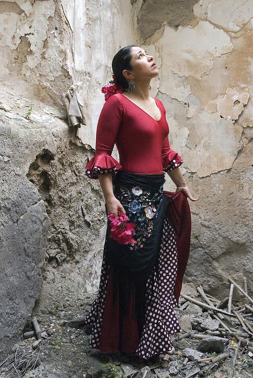 A young Spanish woman wearing traditional Flamenco dress
