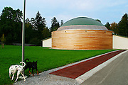 Switzerland, Uzwil, Health Balance clinic for animals....The therapeutic dome: animals move around in a field of positive..vibrations.    ....The big room has a diameter of 26.8 meters and a volume of 5040 m3. It..has been built according to the principles of Global Scaling; a field..of positive waves is formed and reinforced, which has a compensatory..effect on living creatures spending time in the room... The goldfish swims lazily between the fronds of fake seaweed, under the attentive gaze of the medical staff. ?When he came here he was moving all wrong. He swam crooked, he was almost upside-down,? explains Marisa Polanec, obviously enthusiastic at the result. For it appeared that the littlest in-patient at Health Balance, the Swiss clinic for animals, had been suffering from electrosmog poisoning. ..An unusual complaint, yes, but here, in the midst of the clinic?s futuristic architecture and the green hills of San Gallo canton, the concept of normality is done away with even before arriving at a diagnosis. That?s because, to identify the cause of the goldfish?s suffering, Urs Buehler ?kinesiologist and the centre?s founder, as well as the owner of an industrial colossus in the region ?simply asked it, by using his ever-present dowsing rod. .. The goldfish swims lazily between the fronds of fake seaweed, under the attentive gaze of the medical staff. ?When he came here he was moving all wrong. He swam crooked, he was almost upside-down,? explains Marisa Polanec, obviously enthusiastic at the result. For it appeared that the littlest in-patient at Health Balance, the Swiss clinic for animals, had been suffering from electrosmog poisoning. ..An unusual complaint, yes, but here, in the midst of the clinic?s futuristic architecture and the green hills of San Gallo canton, the concept of normality is done away with even before arriving at a diagnosis. That?s because, to identify the cause of the goldfish?s suffering, Urs Buehler ?kinesiologist and the centre?s founder