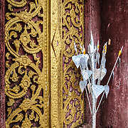 An offering left at Wat Phra That Chomsi at the top of a hill in Luang Prabang, Laos. The Buddhist temple was originally built in 1804 and is reached by a 328-step staircase up the side of the hill.