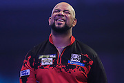 Devon Petersen after his first round defeat to Luke Humphries during the PDC William Hill Darts World Championship at Alexandra Palace, London, United Kingdom on 13 December 2019.