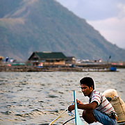 LAKE TAAL (Philippines). 2009. Fisherman in lake Taal with Taal vulcano in the background