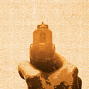 Digitally enhanced image of a back view of a male hand holding a Czech CZ-99 9mm parabelum semi-automatic hand gun Cut out on white background. first shooter experience