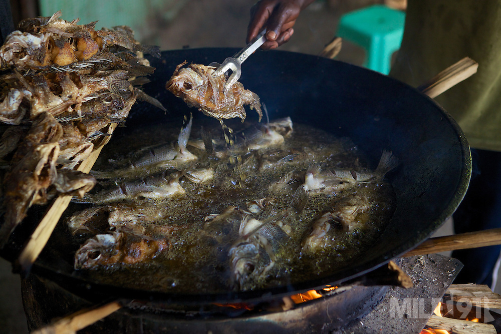 Freshly caught Talapia being fried for breakfast on the shores of Lake Hawassa, Ethiopia