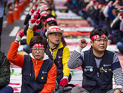 October 9, 2018 - Seoul, Gyeonggi, South Korea - Samsung workers chant before a march in Seoul. Hundreds of Samsung workers marched through central Seoul Tuesday to draw attention to the company's labor issues. Samsung has also started layoffing workers, especially younger ones, as company profits have decreased. (Credit Image: © Jack Kurtz/ZUMA Wire)