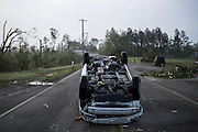 April 29, 2014 - Tupelo, Mississippi, U.S. - <br /> <br /> Deadly Tornadoes Devastate Central and Southern US States<br /> <br /> A car rests on its roof along North Green Street on Tuesday morning after a tornado passed through the area.<br /> ©Exclusivepix