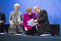 11 MAR 2015, BERLIN/GERMANY:<br /> Christine Lagarde, Geschaeftsfuehrende Direktorin des IWF, Angela Merkel, CDU, Bundeskanzlerin, Angel Gurría, OECD-Generalsekretaer, (v.L.n.R.), im Gespaech, nach einer Pressekonferenz nach einem Gespraech der Bundeskanzlerin mit den Vorsitzenden internationaler Wirtschafts- und Finanzorganisationen, Infosaal, Bundeskanzleramt<br /> IMAGE: 20150311-02-037