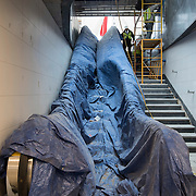 December 12, 2016 - New York, NY :  An escalator leading to street level from the new 72nd Street Second Avenue station, is draped in a blue tarp. After years of delays, the new subway line is preparing to welcome its first straphangers. CREDIT: Karsten Moran for The New York Times