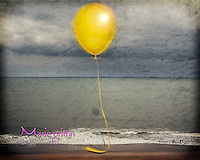 Yellow balloon composite with mud sand from jeep window and a beach storm in Ocean City Maryland.<br />