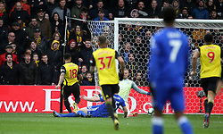 Watford's Andre Gray (left) scores his side's second goal of the game during the Premier League match at Vicarage Road, Watford.
