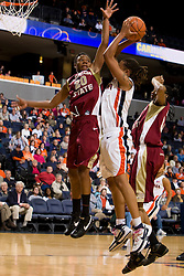 Virginia forward Lyndra Littles (1) is fouled while shooting by Florida St. guard Tanae Davis-Cain (20).  The Virginia Cavaliers women's basketball team defeated the Florida State Seminoles 77-58 at the John Paul Jones Arena in Charlottesville, VA on February 10, 2008.