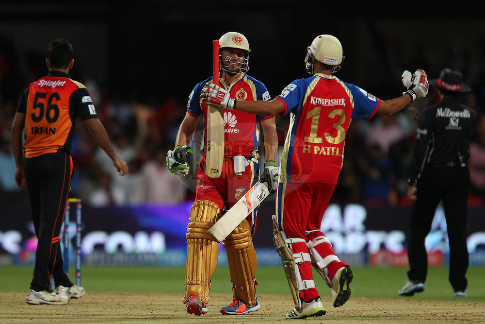 Harshal Patel of the Royal Challengers Bangalore and AB de Villiers of the Royal Challengers Bangalore celebrate the win during match 24 of the Pepsi Indian Premier League Season 2014 between the Royal Challengers Bangalore and the Sunrisers Hyderabad held at the M. Chinnaswamy Stadium, Bangalore, India on the 4th May  2014<br /> <br /> Photo by Ron Gaunt / IPL / SPORTZPICS<br /> <br /> <br /> <br /> Image use subject to terms and conditions which can be found here:  http://sportzpics.photoshelter.com/gallery/Pepsi-IPL-Image-terms-and-conditions/G00004VW1IVJ.gB0/C0000TScjhBM6ikg