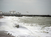 © Licensed to London News Pictures. 11/11/2014. Southsea, UK. Waves crash against the seawall. Wet and windy weather today, 11 November 2014, at Southsea, Portsmouth. The Met Office have issued weather warnings in some parts of the UK. Photo credit : Stephen Simpson/LNP