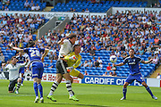 Matt Smith and goalkeeper Simon Moore clash  during the Sky Bet Championship match between Cardiff City and Fulham at the Cardiff City Stadium, Cardiff, Wales on 8 August 2015. Photo by Shane Healey.