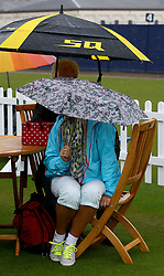 Fans shelter from the rain during day five of the AEGON International at Devonshire Park, Eastbourne.