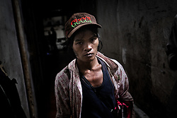 An addict in an abandoned building, Phnom Penh, Cambodia.<br />