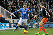 Peterborough United striker Tom Nichols (21) gets takes on Sheffield United defender Danny Lafferty (24) during the EFL Sky Bet League 1 match between Peterborough United and Sheffield Utd at London Road, Peterborough, England on 11 February 2017. Photo by Nigel Cole.
