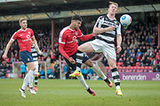 Vadaine Oliver (York City) gets a header in on target but it is saved by Sam Russell (Forest Green Rovers) during the Vanarama National League match between York City and Forest Green Rovers at Bootham Crescent, York, England on 29 April 2017. Photo by Mark PDoherty.