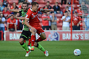 Walsall defender Nicky Devlin (6) battles for possession with Walsall midfielder Kieron Morris (11) 2-1 during the EFL Sky Bet League 1 match between Walsall and Plymouth Argyle at the Banks's Stadium, Walsall, England on 2 September 2017. Photo by Alan Franklin.