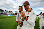 Peter Trego of Somerset and Marcus Trescothick of Somerset on the parade around the County Ground after the win over Nottinghamshire in the Specsavers County Champ Div 1 match between Somerset County Cricket Club and Nottinghamshire County Cricket Club at the Cooper Associates County Ground, Taunton, United Kingdom on 22 September 2016. Photo by Graham Hunt.
