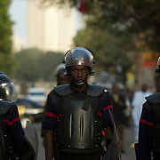 February 24, 2012 - Dakar, Senegal: Policemen take position to prevent presidential candidate Idrissa Seck's supporters to access the Presidential Palace during a rally in the last of day of electoral campaign in central Dakar. (Paulo Nunes dos Santos/Polaris)