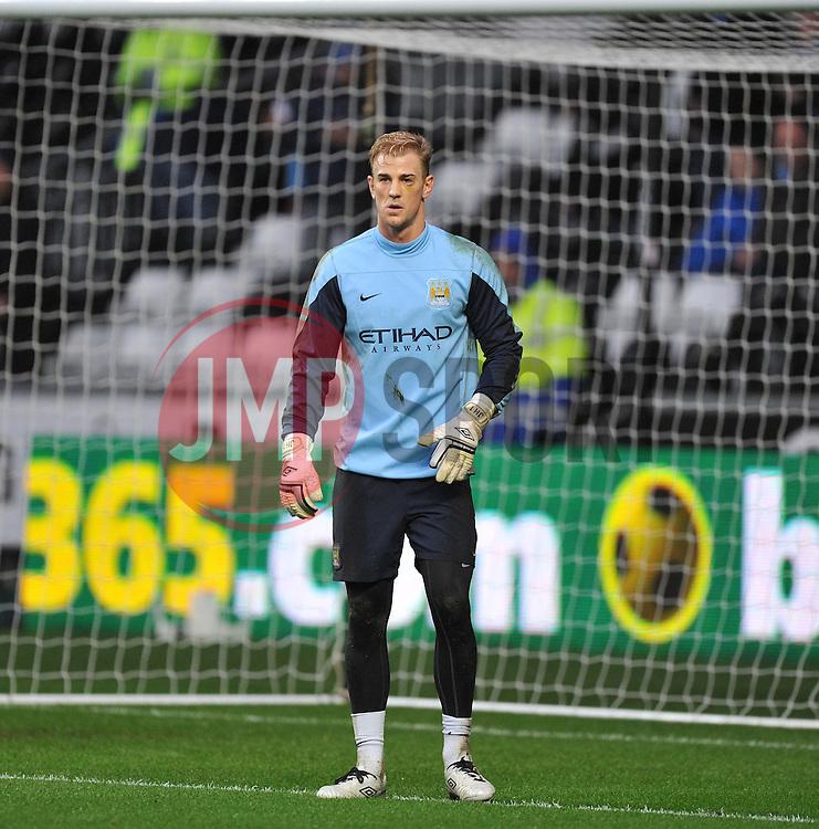 Manchester City's Joe Hart warms up before the game. - Photo mandatory by-line: Alex James/JMP - Tel: Mobile: 07966 386802 01/01/2014 - SPORT - FOOTBALL - Liberty Stadium - Swansea - Swansea City v Manchester City - Barclays Premier League