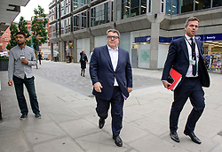 © Licensed to London News Pictures. 20/09/2016. London, UK. Labour party deputy leader TOM WATSON (centre) arrives at Labour Party headquarters in central London for an NEC meeting where Labour Party shadow cabinet selection is due to be discussed. Labour MPs voted overwhelmingly to bring back Shadow Cabinet elections, a move that will need to be passed before the Labour National Executive Committee before it can be agreed on at conference later this month. Photo credit: Ben Cawthra/LNP
