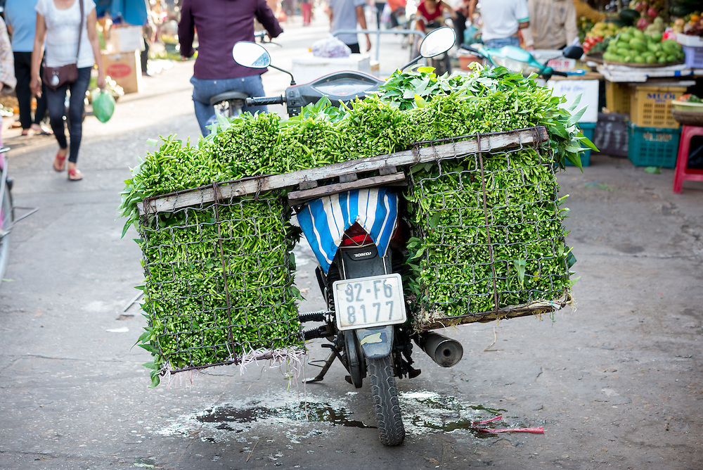 Produce packed for delivery on a motorbike at Hoi An market